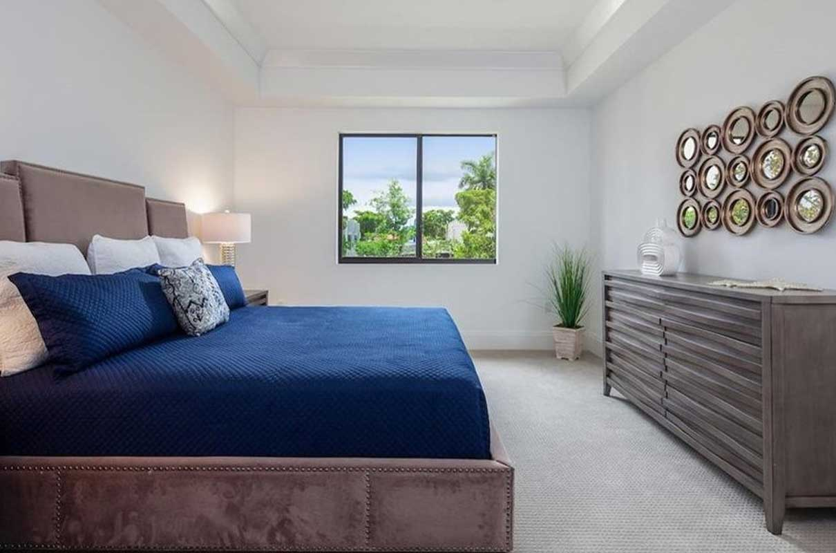 3rd Ave S master bedroom staged by Naples Home Staging | Home Staging Services Southwest Florida Vacant Home Staging and Furnished Home Staging
