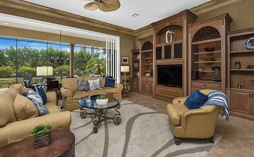 Grey Oaks Family Room Furnished Home Staging | Home Staging Services Naples Home Staging Before & Afters