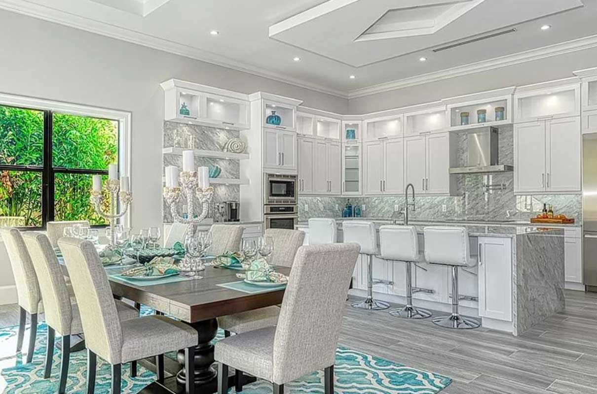 Livingston Woods kitchen and dining room area professional staged by Naples Home Staging