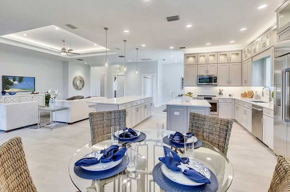 Princess Court kitchen, living room and dinette staged by Naples Home Staging | Home Staging Services Southwest Florida