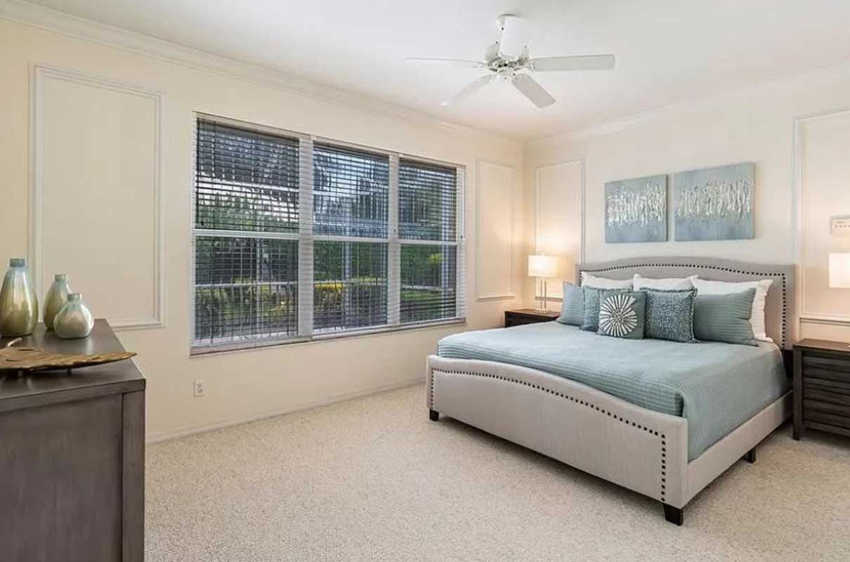 Timmaron Way master bedroom staged by Naples Home Staging | Home Staging Services Southwest Florida